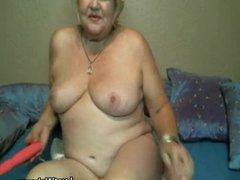 Horny granny masturbates on webcam