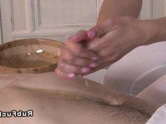 Oiled couple in massage room nuru euro