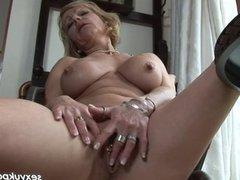 Mature British blonde dildos her pierced cunt