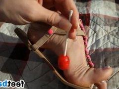 Beautiful Feet In Sandals Outside