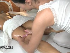 Oiled lesbians on massage table
