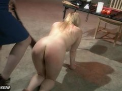 Blonde sub is spanked hard by lesbian dom