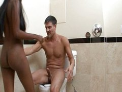 Hot black babe finds cock in bathroom