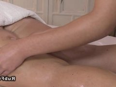 Oiled masseuse fingering and licking customer