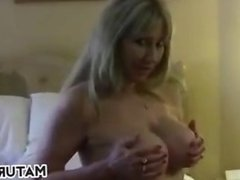 Blonde Woman Shows Off Her Breasts