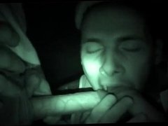 3 friends have fun with a night vision camera