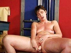 Mature mom probes ass with dildo