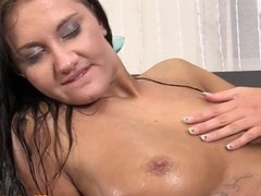 Piss loving brunette peeing on her own face