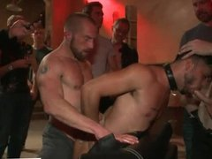 Bound Ray Han in public orgy