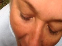 Mature blond woman has oral sex outside