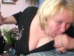 Huge grandma riding and sucking both cocks