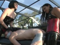Femdom Strapon mistresses duct tape ass
