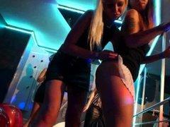 Lesbian pornstars having fun in a club