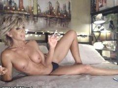Sexy blonde MILF smoking on webcam