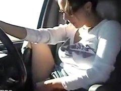 Hot babe masturbates while driving