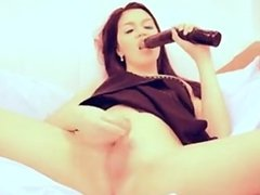 Brunette TS wanking with a dildo in her ass