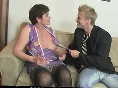Old bitch in black stocking rides his cock