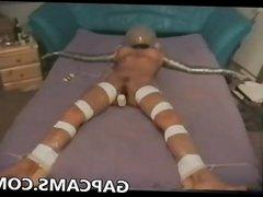 Slave in extreme bondage to cum on webcam
