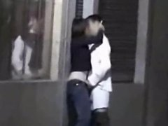 Couple fooling around on the street