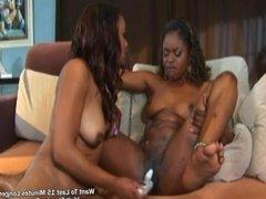 Two horny ebony sharing and toying pussy
