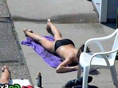 Topless Teen Getting A Tan