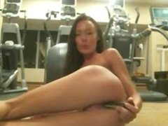hot babe uses dildo at the gym