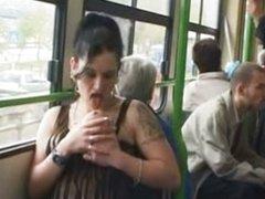 Whore masturbates in public tram