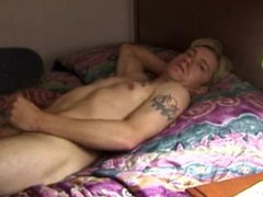 Solo masturbating twink wanks himself