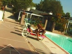 Ebony licking pussy by the pool