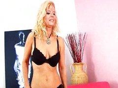 Blonde MILF in stockings is dildoing