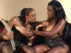 Dildo-sharing busty black sluts