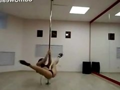 Cam Girl Practices Pole Dancing