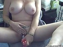 Tattooed MILF With Her Toy