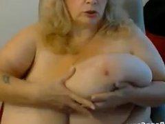 Mature BBW Sucking Her Tits