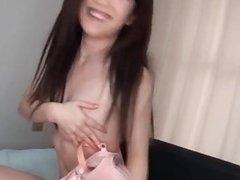 Horny Japanese milf puts on a kinky