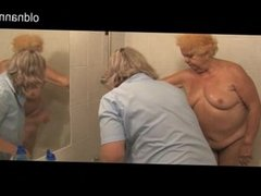 Old uniformed mature nurse bathes very old ch