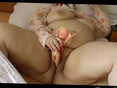 BBW granny in bed with toy