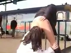 Crazy girls lick each other on the station!