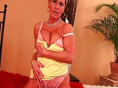 Hairy granny with hanging big tits dildoing