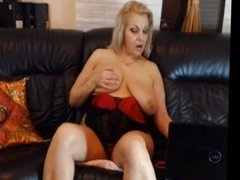 Glamorous mom plays her big tits