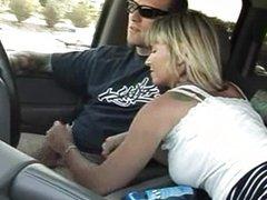 Mature woman gives car driver a nice blowjob