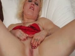 Horny blonde milf loves playing