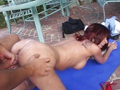 Outdoor brunette MILF pounding pussy