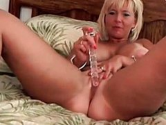Blonde slut licks a dildo and loves