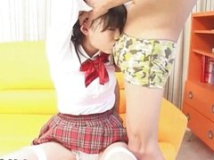 Horny Japanese teen in school uniform sucks