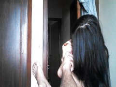 Brazilian girl adoring and licking the feet o