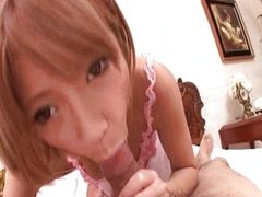 Asian cutie in pink gives blowjob
