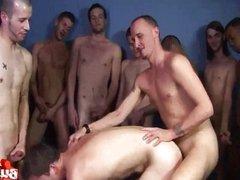 Bareback bukkake orgy in a gym