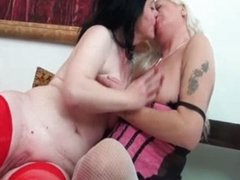 Two mature lesbian women are kissing