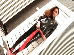 Shemale in latex uniform fingering